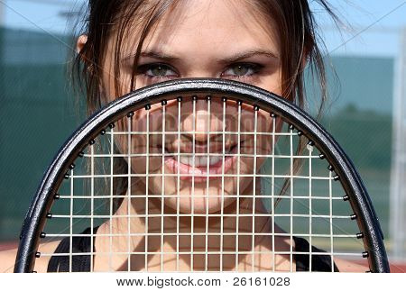 Brunette Female Tennis Player with her racket