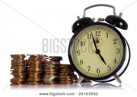 time is money concept photo, uk coins against retro alarm-clock