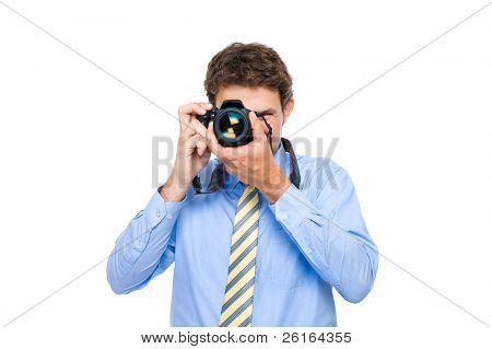 young businessman in blue shirt and necktie takes photo with dslr camera, studio shoot isolated on white background