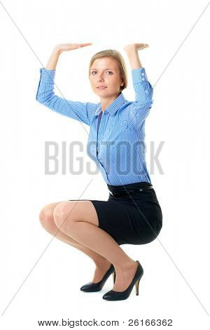 woman in blue shirt holds imaginary item over her head, isolated on white