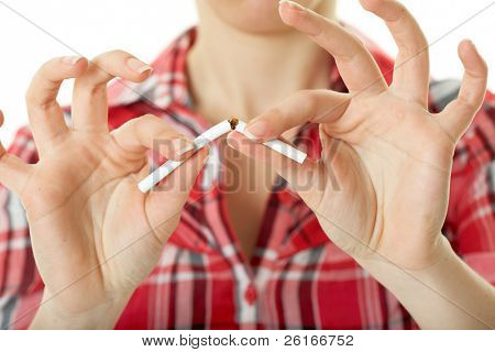 female in red shirt breaks cigarette, quit smoking concept