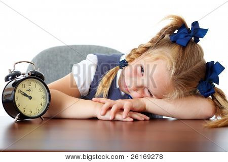 Tired young cute school girl sleep at her desk, tired, overworked, isolated on white background