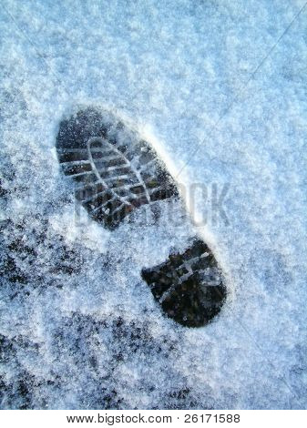 Isolated footprint in the crusty icey snow