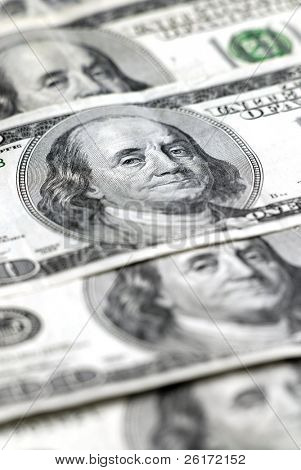 Closeup of hundred dollar bills isolated on white background