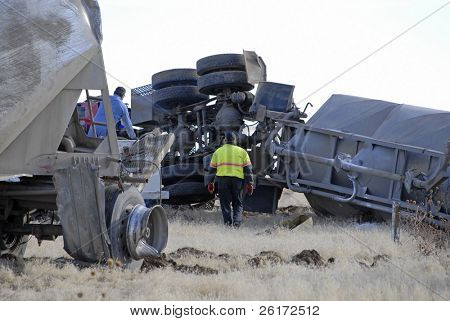 Car Wreck with Smashed Hood and Rolled on its Side