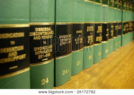 Close up of several volumes of law books of codes and statutes on divorce