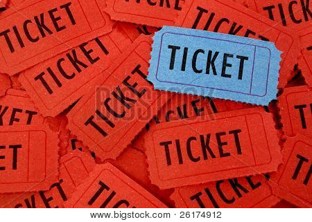 Pile of many red and one blue tickets  for admission to an event