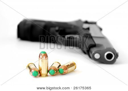 Closeup of tactical military bullets and gun isolated on white