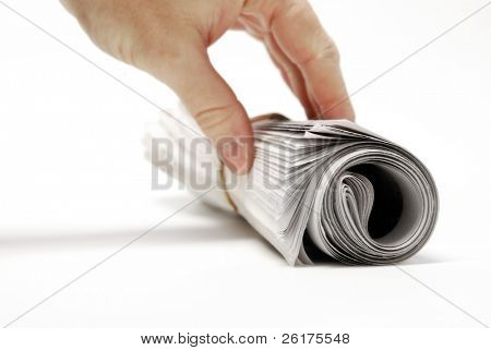 Rolled up newspaper isolated on white background with hand reaching