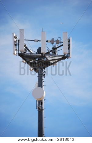 Communications Tower With Airplane Overhead