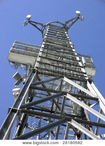 An communictions aerial tower against a clear blue sky