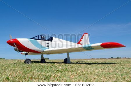A Radio Control Aircraft parked on the grass