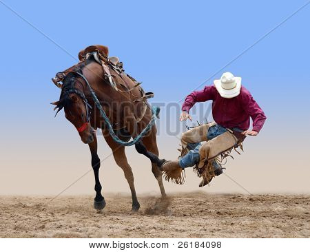 Cowboy bucked of a bucking Bronco isolated with path