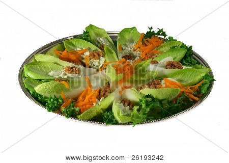 A lettuce, sweetcorn and capsicum salad on a silver tray. Isolated