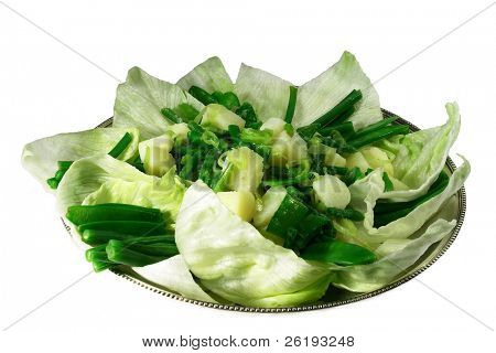 Salad with green beans, lettuce and mangetout on a silver tray, isolated.