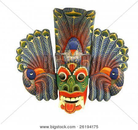 The Sri Lankan Peacock Devi mask,l Mayura Raksha, brings peace, harmony and wealth, according to the superstition. Very shallow depth of field. Isolated on white