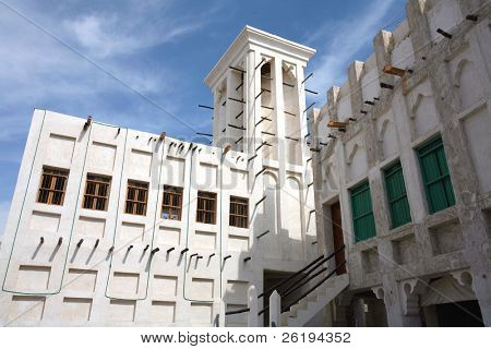 Traditional Arab architecture, including a wind tower, in the newly rebuilt Old Souq of Doha, Arabia.