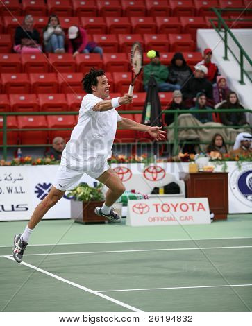 Morocco's Younes El Aynaoui hurls his racket on to the ball during his first round win in the Qatar Open, January 2007.