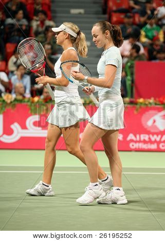Former world No 1 Martina Hingis (R) and rising Russian star Maria Kirilenko in action together - a formidable partnership in the doubles tournament at Qatar Total Open, February 27, 2007