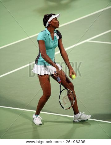 Top US tennis star Venus Williams serving in a doubles match in Doha, Qatar, February 19, 2008. Williams and her partner, young Danish sensation Caroline Wozniacki, won in a thrilling tie-break.