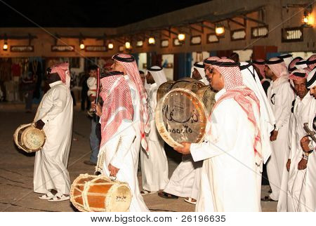 A qatari folk troupe performing at the Heritage Village on Doha Corniche during the Doha Cultural Festival, February/March 2008.