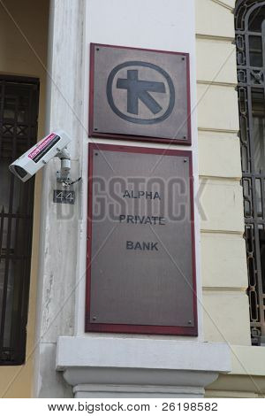 HERAKLION, GREECE - JULY 27: A branch or Alpha Bank in Heraklion (Iraklio), Crete. Alpha Bank's part of Greek sovereign debt was put at 4.6 billion euros in June 2011. July 27, 2010 in Heraklion, Crete, Greece