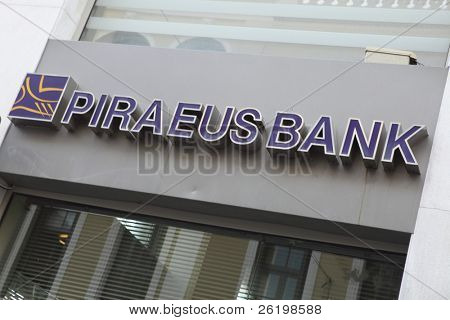 HERAKLION, GREECE - JULY 27: A Piraeus Bank, Heraklion (Iraklio), Crete branch sign. In June 2011 Piraeus Bank's Greek part of Greek State debt was 8,700 million euros. July 27, 2010 in Heraklion, Crete, Greece