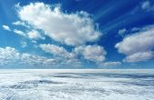 Winter Landscape With Ice, Snow, And Clouds. Deep Horizon And Low Beautiful Clouds. poster