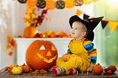 Kids In Witch Costume On Halloween Trick Or Treat poster