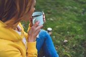 Happy Girl Holding In Hands Cup Of Hot Tea On Green Grass In Outdoors Nature Park, Beautiful Woman H poster