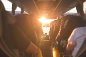 Background, Bus Interior. The Salon Of The Bus With People Fill The Sun With Light In The Sunset. Pe poster