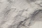 White Sand Beach Texture. Marine Coast Top View Photo. Natural Texture. Smooth Sand Surface With Win poster