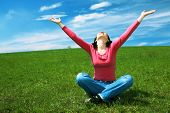 stock photo of hands up  - woman in field hold hand palm up under blue sky and clouds - JPG