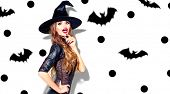 Halloween Party girl in with costume celebrating. Happy Halloween Witch with bright make-up and long poster