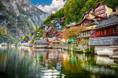 Sunny Autumnal Day At Famous Hallstatt Lakeside Town Reflecting In Hallstattersee Lake. Location: Re poster