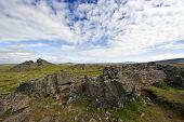 stock photo of errat  - Erratic lava formations across the tundra over the volcanic mountain range the Kerlingafjoll in Hveravellir - JPG