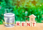 Wooden House, Money With The Inscription Rent. Rental Of Property, Apartments. Services Of A Realtor poster