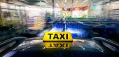 stock photo of raid  - A taxi at high speed closing in on a night shop for a ram raid - JPG