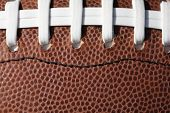 stock photo of ncaa  - Close up of football laces - JPG