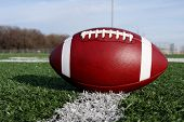stock photo of ncaa  - Close up of an american football on the field - JPG