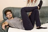 Lazy Man With The Remote On The Couch poster