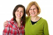 stock photo of mother daughter  - happy mother and daughter standing back to back - JPG