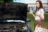 attractive brunette in front of her car broken down car, assistance concept