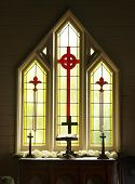 foto of stained glass  - Decorative Glass windows in a church prepared for a wedding - JPG