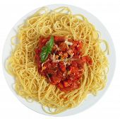 Close-up vertical view of Spaghetti al Pomodoro - spaghetti with tomato and vegetable sauce, topped