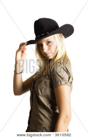 Young Rodeo Cowgirl  Holding Cowboy Hat