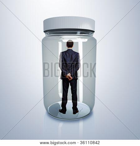 Businessman inside glass jar