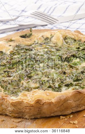 Spinach Quiche On A Wooden Board