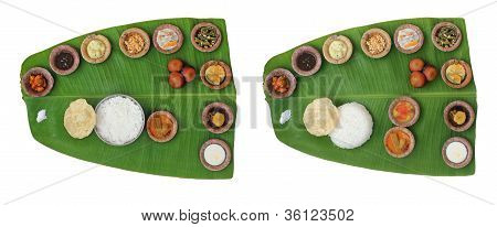 Sumptuous And Wholesome Onam Meals Called Sadhya In Kerala. The Lunch Contains Varieties Of Curries
