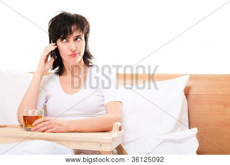 Woman In Bed Talking By Phone With Glass On Juice On Tray